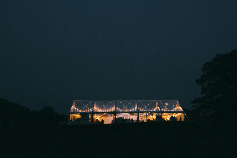 clear tent wedding at night