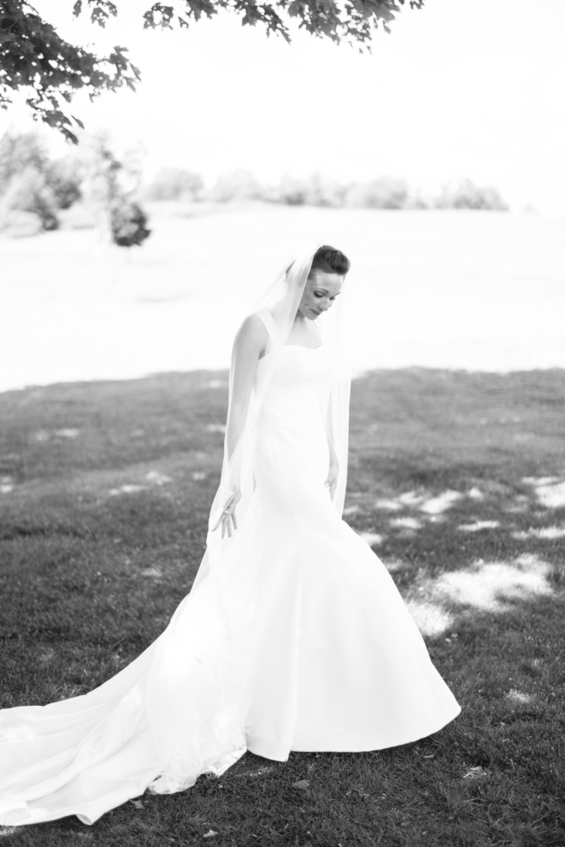 bride and groom first look at north haven golf course